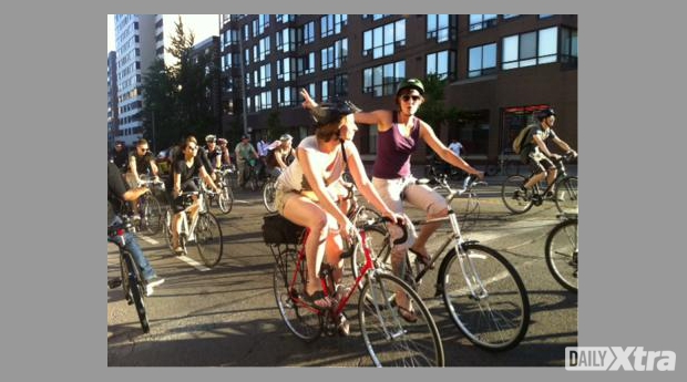 In protest of city council's decision to cut bike lanes, more than 120 cyclists organized an im...