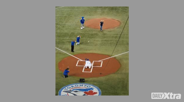 David Testo throws the game's first pitch on Sept 27.
