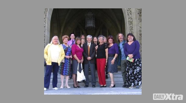 NDP MP Bill Siksay, flanked by trans activists and allies, outside the House of Commons on June...